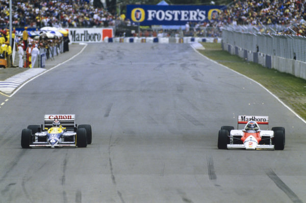 Keke Rosberg, McLaren MP4-2C TAG, sparks as he battles Nelson Piquet, Williams FW11 Honda.