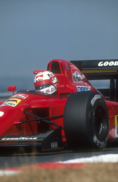 1990 Hungarian Grand Prix.Hungaroring, Budapest, Hungary.10-12 August 1990.Nigel Mansell (Ferrari 641). He was lying third when Berger hit him on lap 72 and exited the race.Ref-90 HUN 06.World Copyright - LAT Photographic