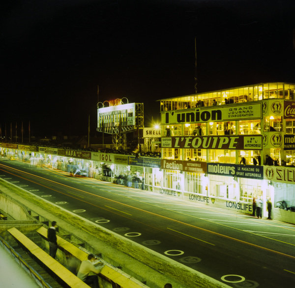 Cars on track at night.
