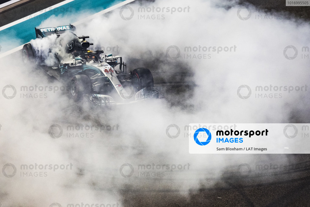 Lewis Hamilton, Mercedes AMG F1, 1st position and 2018 world champion, performs donuts on the grid at the end of the race