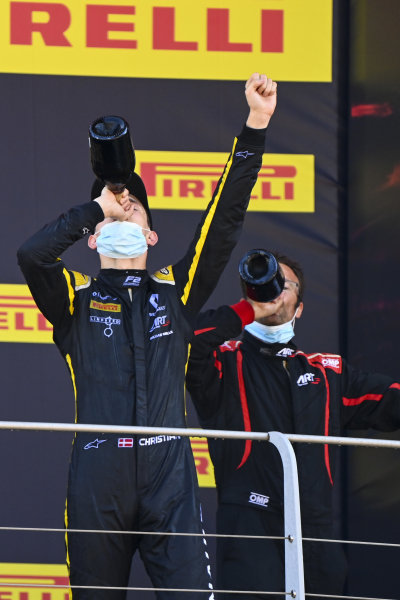 Christian Lundgaard (DNK, ART GRAND PRIX), 1st position, downs Champagne on the podium