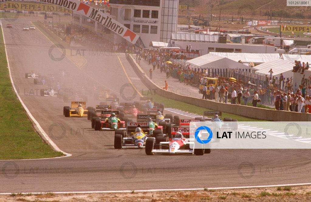 Jerez, Spain.30/9-2/10 1988.Alain Prost (McLaren MP4/4 Honda) leads Nigel Mansell (Williams FW12 Judd) and Ayrton Senna (McLaren MP4/4 Honda) at the start. Ref-88 ESP 09.World Copyright - LAT Photographic