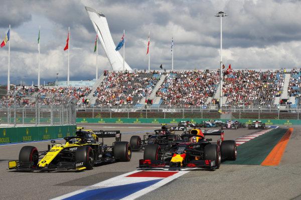 Nico Hulkenberg, Renault R.S. 19, leads Max Verstappen, Red Bull Racing RB15, and Kevin Magnussen, Haas VF-19