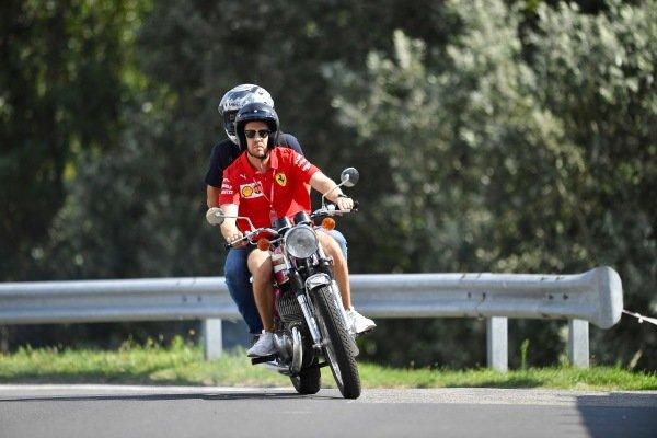 Sebastian Vettel, Ferrari, on his motorcycle