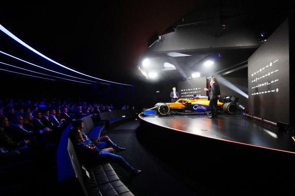 Simon Lazenby, Sky TV, Lando Norris, McLaren, and Carlos Sainz Jr, McLaren, on stage at the launch of the MCL35. Carlos Sainz Jr, McLaren, and Lando Norris, McLaren, watch from the front row
