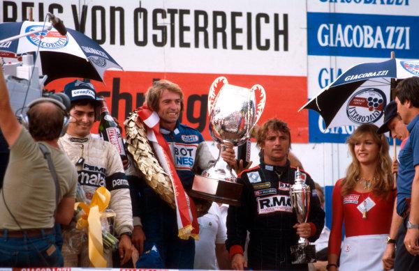 1981 Austrian Grand Prix.Osterreichring, Zeltweg, Austria.14-16 August 1981.Jacques Laffite (Talbot Ligier Matra) 1st position, Rene Arnoux (Equipe Renault) 2nd position and Nelson Piquet (Brabham Ford) 3rd position on the podium.Ref-81 AUT 10.World Copyright - LAT Photographic