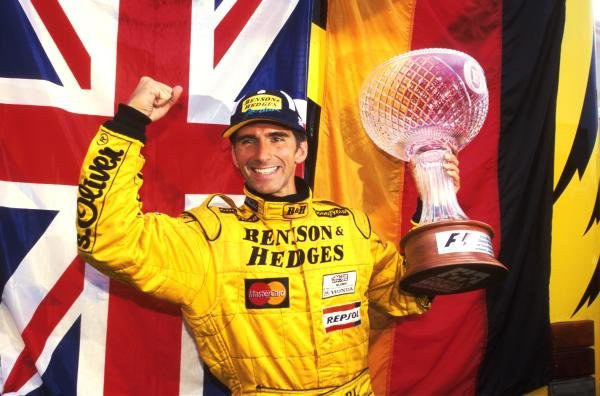 Winner Damon Hill (GBR) Jordan Mugen Honda 198 celebrates after his win Formula One World Championship, Rd 13, Belgian Grand Prix, Spa Francorchamps, Belgium, 30 August 1998