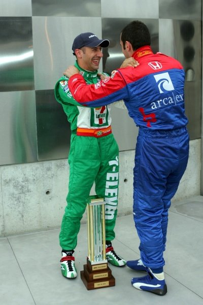 L-R: Tony Kanaan (BRA), Andretti Green Racing, won the pole for the 89th Indy 500 and is congratulated by Dario Franchitti (GBR).