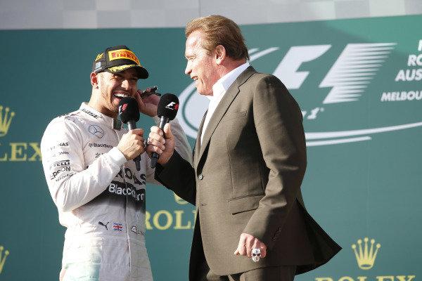 Albert Park, Melbourne, Australia. Sunday 15 March 2015. Actor Arnold Schwarzenegger interviews Lewis Hamilton, Mercedes AMG, 1st Position, on the podium. World Copyright: Glenn Dunbar/LAT Photographic. ref: Digital Image _W2Q4979