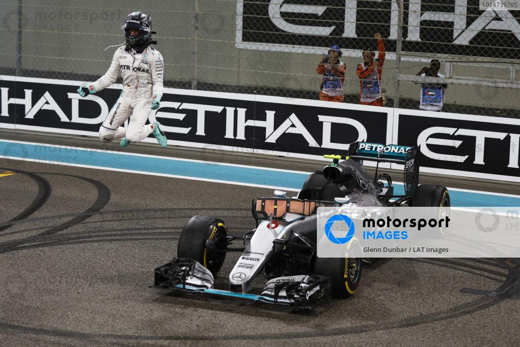 Yas Marina Circuit, Abu Dhabi, United Arab Emirates. Sunday 27 November 2016. Nico Rosberg, Mercedes F1 W07 Hybrid, celebrates as he jumps from his car after winning the World Championship. World Copyright: Glenn Dunbar/LAT Photographic ref: Digital Image _X4I5201
