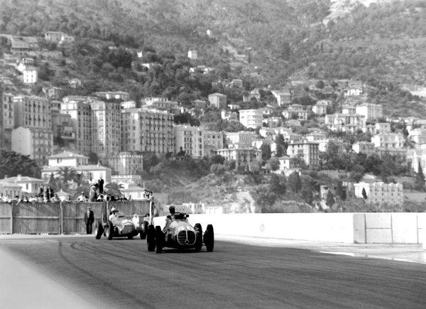 1950 Monaco Grand Prix.Monaco, Monte Carlo. 21st May 1950.Louis Chiron (Maserati 4CLT/48) leads Juan Manuel Fangio (Alfa Romeo 158). Ref-C26706.World Copyright: LAT Photographic