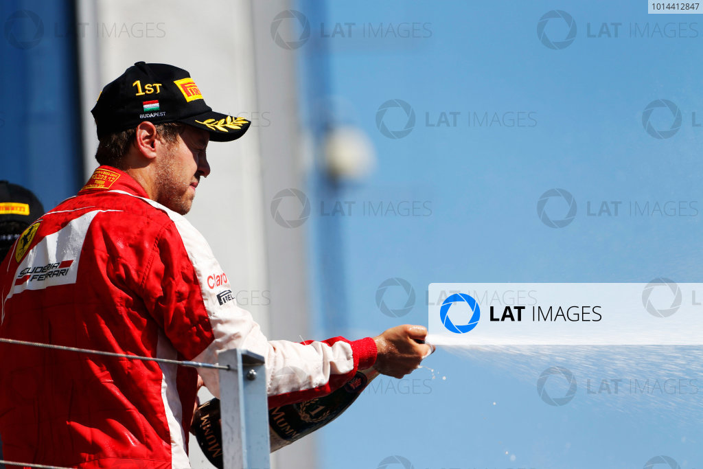 Hungaroring, Budapest, Hungary. Sunday 26 July 2015. Sebastian Vettel, Ferrari, 1st Position, on the podium. World Copyright: Sam Bloxham/LAT Photographic ref: Digital Image _SBL8338