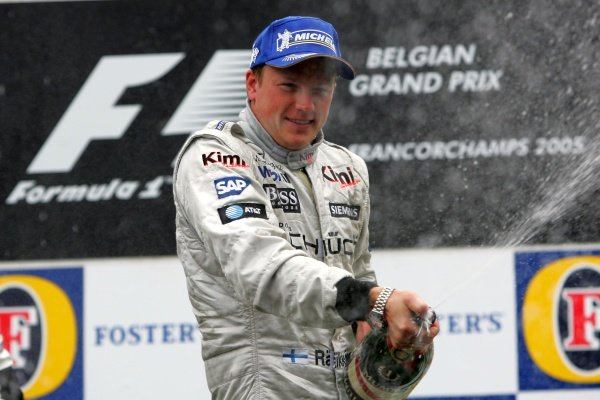Race winner Kimi Raikkonen (FIN) McLaren sprays the champagne on the podium. 