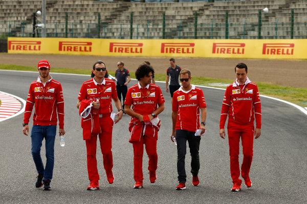 Suzuka Circuit, Japan. Thursday 05 October 2017. Sebastian Vettel, Ferrari, walks the track with his team. World Copyright: Andy Hone/LAT Images  ref: Digital Image _ONZ0689