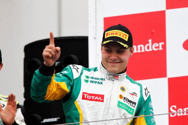 Round 5. Nurburgring, Germany. 24th July 2011.Race Two.Valtteri Bottas, (FIN, Lotus ART) celebrates victory on the podium.Portrait. Photo: Andrew Ferraro/GP3 Media Service.    ref: Digital Image _Q0C8936