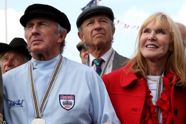(L to R): Sir Jackie Stewart (GBR) and wife Helen Stewart (GBR) and Jo Ramirez (MEX). Goodwood Revival, Goodwood, West Sussex, England, 12-14 September 2014.