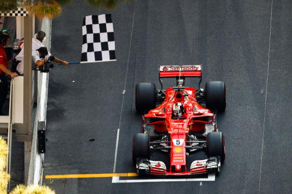 Monte Carlo, Monaco. Sunday 28 May 2017. Sebastian Vettel, Ferrari SF70H, takes the chequered flag to win the race. World Copyright: Glenn Dunbar/LAT Images ref: Digital Image _31I1894