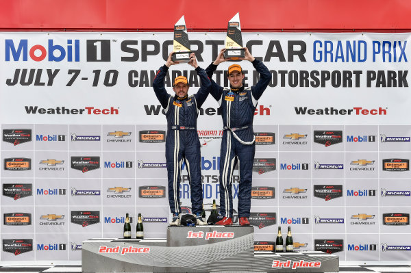 7-9 July 2016, Bowmanville, Ontario Canada 15, Ford, Shelby GT350R-C, GS, Scott Maxwell, Billy Johnson celebrate the win on the podium in victory lane ?2016, Scott R LePage  LAT Photo USA