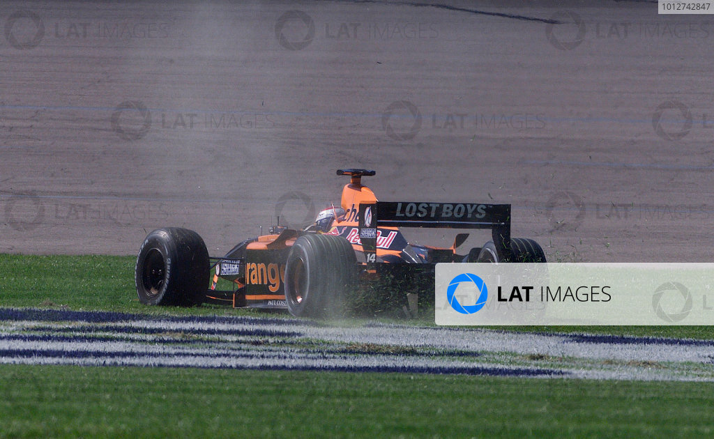2001 American Grand Prix - RaceIndianapolis, United States. 30th September 2001.Jos Verstappen, Arrows A22 AsiaTech, spins across the grass.World Copyright: Steve Etherington/LAT Photographicref: 18mb Digital Image