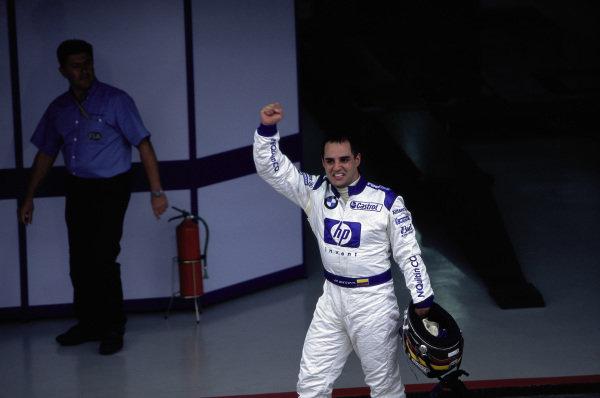 Juan Pablo Montoya celebrates victory in parc ferme.
