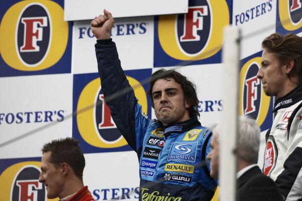 Fernando Alonso celebrates victory on the podium.