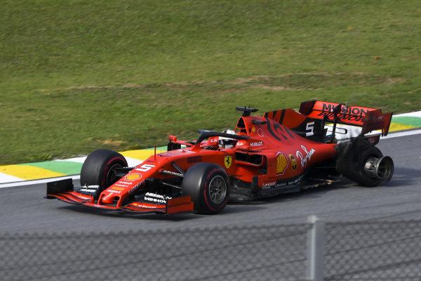 Sebastian Vettel, Ferrari SF90, with damage after making contact with his team mate Charles Leclerc, Ferrari SF90