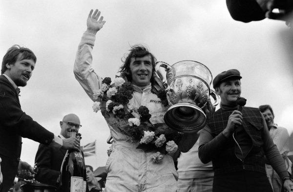Race winner Jackie Stewart on the podium.