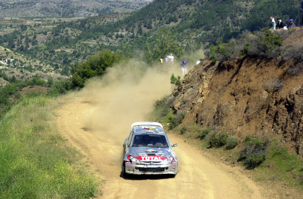 World Rally Championship, Cyprus Rally, April 18-21, 2002.Gilles Panizzi on Stage 6, Leg 1, his Peugeot 206 WRC showing damage from a roll on Stage 3.Photo: Ralph Hardwick/LAT