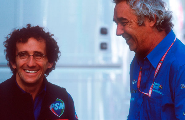 2001 Austrian Grand Prix. A1-Ring, Zeltweg, Austria. 11-13 May 2001.Prost Chairman Alain Prost with Benetton Managing Director Flavio Briatore.World Copyright - LAT Photographic