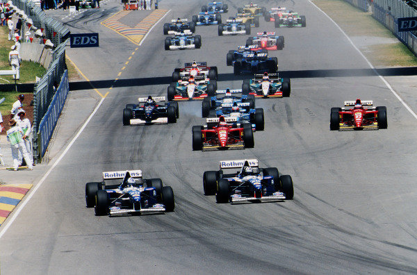 1995 Australian Grand Prix. Adelaide, Australia. 10-12 November 1995. Damon Hill leads teammate David Coulthard (both Williams FW17B Renault's) into the first corner at the start of the race, as the pack follows. Ref-95 AUS 16. World Copyright - LAT Photographic