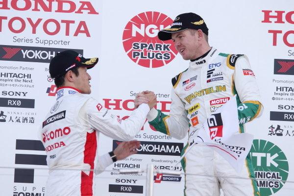 Winner Nick Cassidy, VANTELIN TEAM TOM'S, Dallara SF19 Toyota, celebrates on the podium, ahead of Naoki Yamamoto, DOCOMO TEAM DANDELION RACING, Dallara SF19 Honda, 2nd. Photo by Masahide Kamio