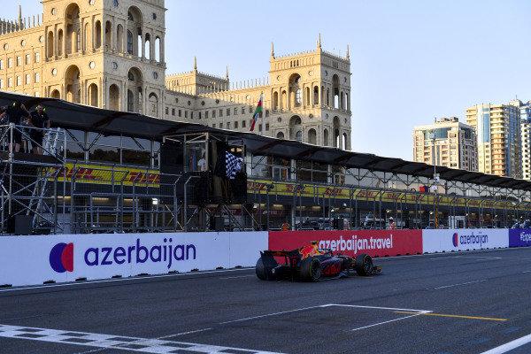 Juri Vips (EST, Hitech Grand Prix), passes the chequered flag