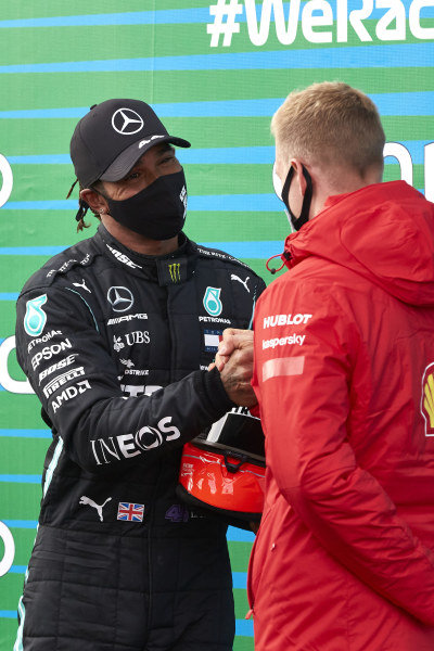 Mick Schumacher presents Lewis Hamilton, Mercedes-AMG Petronas F1, 1st position, with his fathers helmet after the Mercedes driver equalled Michael Schumachers record 91 race wins