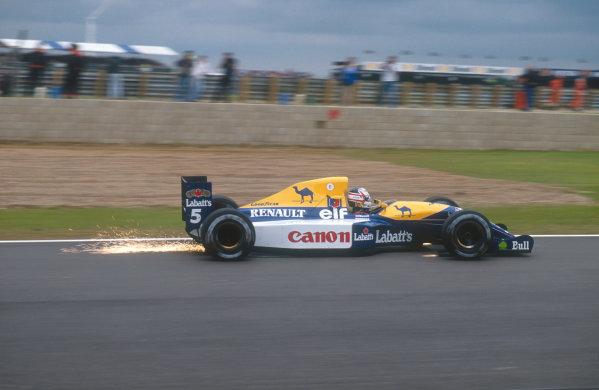 1991 British Grand Prix.Silverstone, England.12-14 July 1991.Nigel Mansell (Williams FW14 Renault) 1st position.Ref-91 GB 03.World Copyright - LAT Photographic