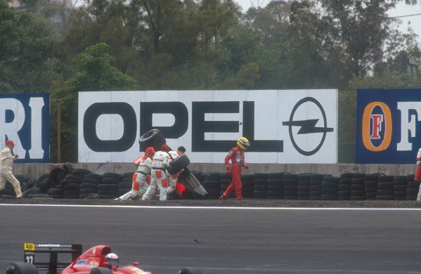 1991 Mexican Grand Prix.Mexico City, Mexico. 14-16 June 1991.Ayrton Senna (McLaren MP4/6 Honda) came off at Peraltada during Friday qualifying and hit the tyre barrier, which flipped his car over in the gravel. He was unhurt in the accident. Ref-91 MEX 04.World Copyright - Tee/LAT Photographic