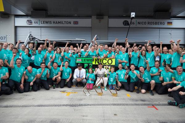 Red Bull Ring, Spielberg, Austria. Sunday 21 June 2015. Nico Rosberg, Mercedes AMG, 1st Position, and Lewis Hamilton, Mercedes AMG, 2nd Position, celebrate with the Mercedes AMG team. World Copyright: Steve Etherington/LAT Photographic. ref: Digital Image SNE14885