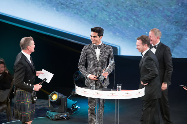 2017 Autosport Awards Grosvenor House Hotel, Park Lane, London. Sunday 3 December 2017. Enaam Ahmed on stage with Christian Horner and Martin Brundle to accept the British Club Driver of the Year Award. World Copyright: Joe Portlock/LAT Images  ref: Digital Image _R3I5803