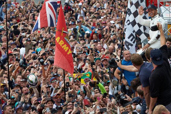 Silverstone, Northamptonshire, UK.  Sunday 16 July 2017. Lewis Hamilton, Mercedes AMG, celebrates with the fans after winning the race. World Copyright: Steve Etherington/LAT Images  ref: Digital Image SNE19538