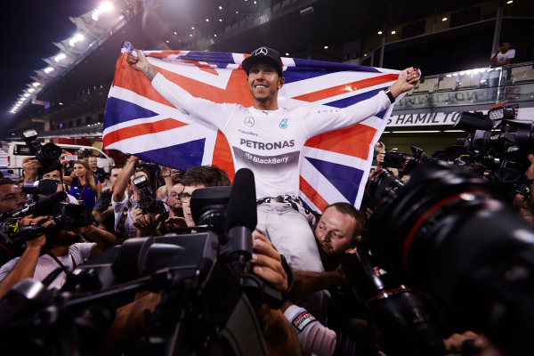 Yas Marina Circuit, Abu Dhabi, United Arab Emirates. Sunday 23 November 2014.  Lewis Hamilton, Mercedes AMG, celebrates championship victory.  World Copyright: Steve Etherington/LAT Photographic. ref: Digital Image SNE13432