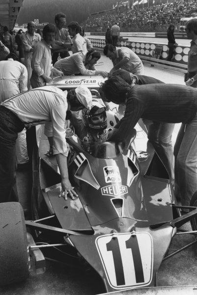 Osterreichring, Zeltweg, Austria 12th -14th August 1977. Niki Lauda (Ferrari 312T2), 2nd position, in the pits, portrait. World Copyright: LAT Photographic. Ref: B/W Print.