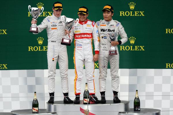 Race 2 podium (L to R): Second placed Stoffel Vandoorne (BEL) ART Grand Prix, race winner Rio Haryanto (INA) Trident and third placed Nobuharu Matsushita (JPN) ART Grand Prix celebrate on the podium at GP2 Series, Rd4, Spielberg, Austria, 19-21 June 2015.