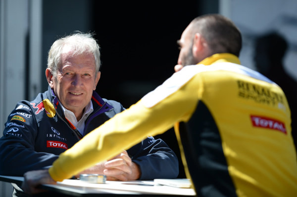 Dr Helmut Marko (AUT) Red Bull Motorsport Consultant talks with Cyril Abiteboul (FRA) Renault Sport at Formula One World Championship, Rd1, Australian Grand Prix, Race, Albert Park, Melbourne, Australia, Sunday 15 March 2015.