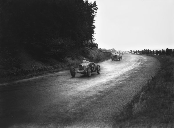 Nurburgring, Germany. 19th July 1931. Louis Chiron (#26 Bugatti T51), 2nd position,  leads Manfred von Brauchitsch (#2 Mercedes-Benz SSKL), retired, action.  World Copyright: LAT Photographic. Ref:  Autocar Glass Plate B6831