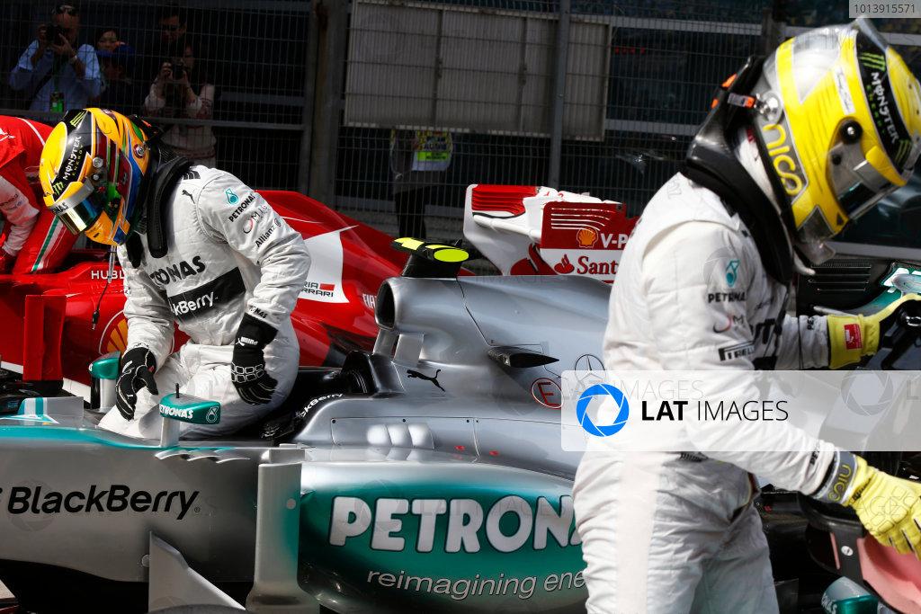 Shanghai International Circuit, Shanghai, China Saturday 13th April 2013 Lewis Hamilton, Mercedes AMG, and Nico Rosberg, Mercedes AMG, in Parc Ferme. World Copyright: Charles Coates/LAT Photographic ref: Digital Image _N7T4369