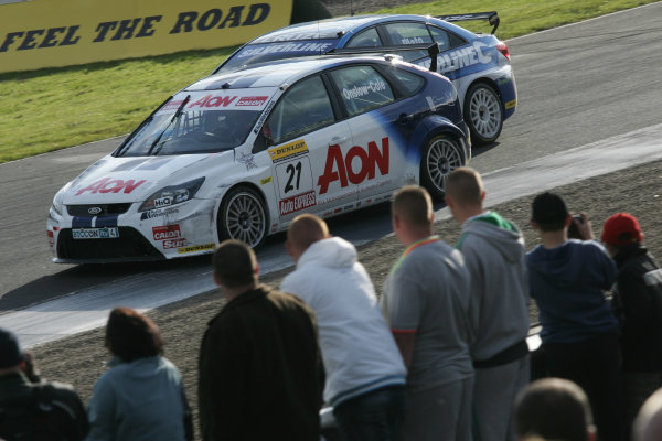 Knockhill, Scotland. 4th and 5th September 2010,Tom Onslow Cole (GBR) Team Aon Arena Ford Focus and Jason Plato (GBR) - RML Chevrolet CruzeWorld Copyright: Ebrey/LAT Photographic
