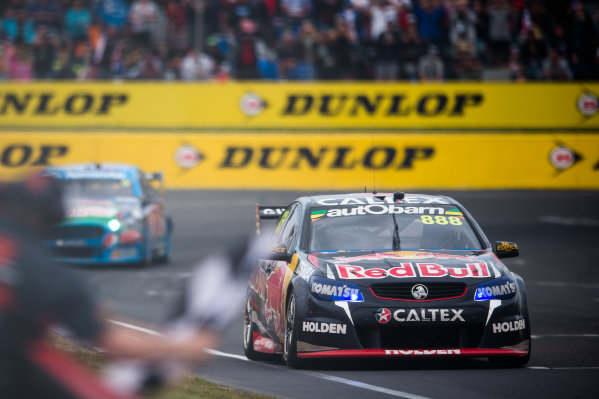 2015 V8 Supercars Round 10. Bathurst 1000, Mount Panorama, NSW, Australia. Thursday 8th October - Sunday 11th October 2015. Craig Lowndes drives the #888 Red Bull Racing Holden VF Commodore takes the chequered flag to with the Bathurst 1000. World Copyright: Daniel Kalisz/LAT Photographic  Ref: Digital Image V8SCR10_BATHURST1000_DKIMG07588.JPG