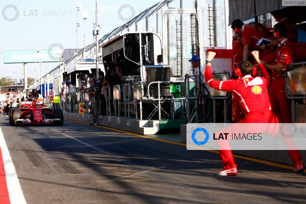 Albert Park, Melbourne, Australia. Sunday 26 March 2017. A Ferrari team member celebrates as Sebastian Vettel, Ferrari SF70H, 1st Position, returns to the pits. World Copyright: Andy Hone/LAT Images ref: Digital Image _ONZ2402