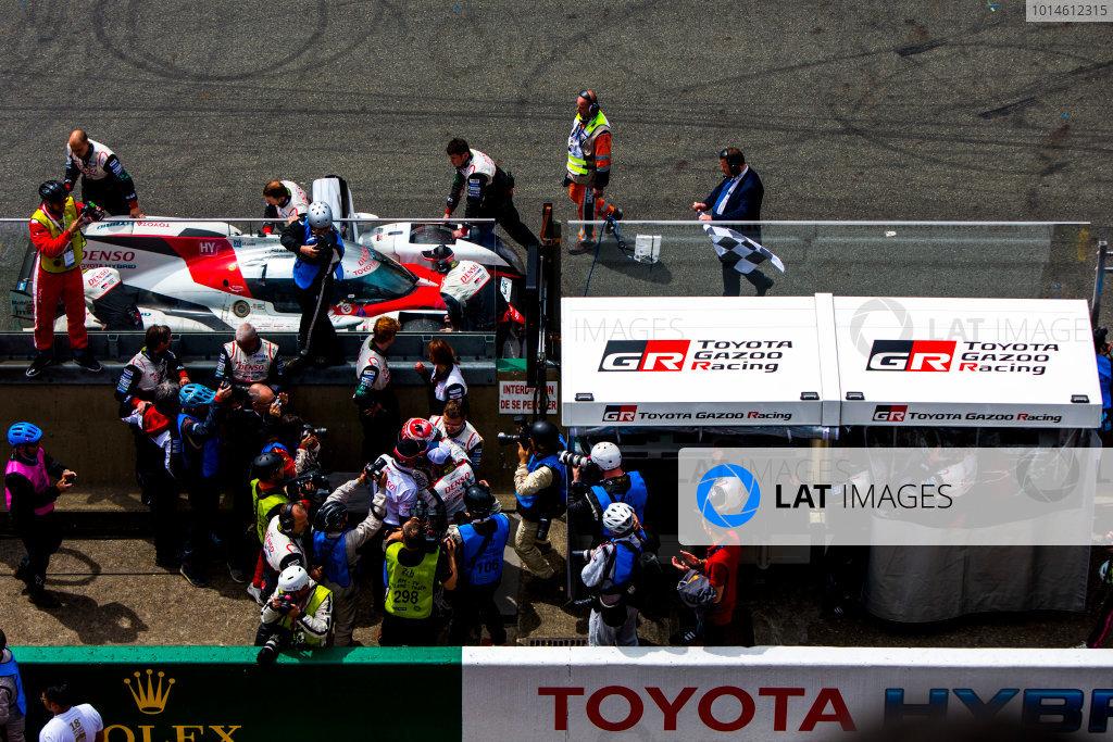2016 Le Mans 24 Hours. Circuit de la Sarthe, Le Mans, France. Sunday 19 June 2016. Toyota Gazoo Racing / Toyota TS050 - Hybrid - Anthony Davidson (GBR), Sebastien Buemi (CHE), Kazuki Nakajima (JPN), stops on track outside the Toyota pit wall. World Copyright: Zak Mauger/LAT Photographic ref: Digital Image _79P8927