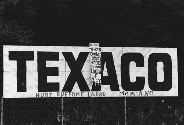 Monza, Italy. 10th - 12th September 1976. A Texaco hoarding with graffiti on it, atmosphere. World Copyright: LAT Photographic. Ref: 9122 - 5.