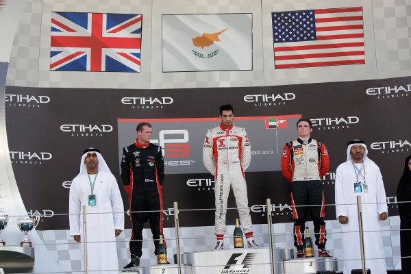 2013 GP3 Championship, Round 8. Yas Marina Circuit, Abu Dhabi, United Arab Emirates. Dean Stoneman (GBR, Koiranen GP), Tio Ellinas (CYP, Marussia Manor Racing) & Conor Daly (USA, ART Grand Prix), on the podium 3rd November, 2013. Sunday Race Two. World Copyright: Sam Bloxham/LAT Photographic. ref: Digital Image _LOX4113